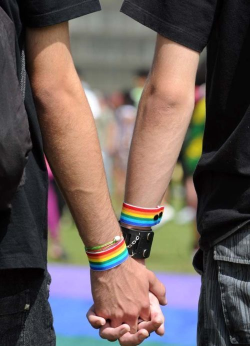 "A gay couple holds hands during the 2nd Gay Parade Against Homophobia in Brasilia in support of gays, lesbians and transgenders in Brasilia, on May 18, 2011. Brazil's Supreme Court on May 5, 2011 recognized the legal rights of same-sex partners in ""stable"" civil unions. President Dilma Rousseff's Attorney General Roberto Gurgel had backed the plan granting gays and lesbians the right to form civil unions, and on guaranteeing them the same legal rights as same-sex couples. AFP PHOTO/Evaristo SA"